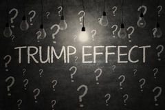 Light bulbs with Trump Effect word. JAKARTA, November 17, 2016: Image of light bulbs with Trump Effect word and question marks on the blackboard Stock Photography