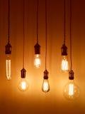 Light bulbs on warm orange background Royalty Free Stock Image