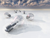 Light bulbs on white with reflecting clouds Royalty Free Stock Image