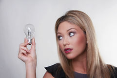 Light bulbs and the woman Royalty Free Stock Images