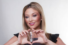 Light bulbs and the woman Royalty Free Stock Photography