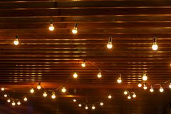 Light bulbs on wooden background,