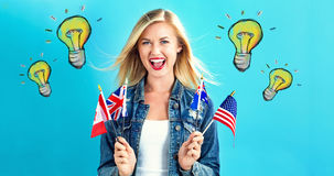 Light bulbs with young woman with flags. Of English speaking countries royalty free stock image