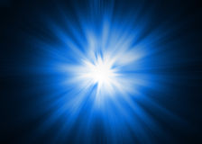 Light Burst - XL. Dramatic blue and white Light burst / Sunburst on a black background Royalty Free Stock Image