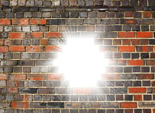 Light bursting through a brick wall Stock Photography