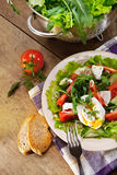 Fresh lidht salad with poached egg Royalty Free Stock Photo