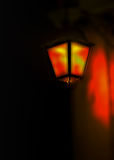 Light of a candelabrum. Orange and yellow glow of a candelabrum in the dark night Royalty Free Stock Images