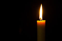 Light on candle. With black background Stock Images