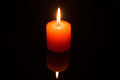 Light a candle on black background Royalty Free Stock Photos