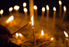 Light a Candle in the church Royalty Free Stock Images