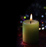 Light candle on dark Royalty Free Stock Images