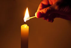 Light a candle. In the dark Stock Photography