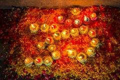Light candle and flower& x27;s decorate of OM is symbol of hindu reli Stock Photography