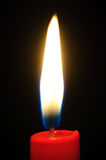 Light of candle growing from the dark Royalty Free Stock Images