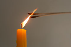 Light candle is the ignite of incense. Royalty Free Stock Image