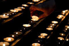 Light the candle. A man is lighting a candle in St. Vitus Cathedral, Vienna Stock Photography