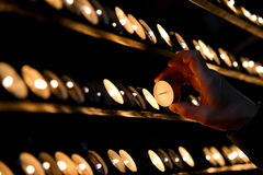 Light the candle. A man is lighting a candle in St. Vitus Cathedral, Vienna Royalty Free Stock Photos