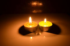 Light of candle pots in the dark Stock Photos