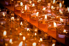 Light a candle in red glass Royalty Free Stock Images