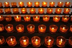 Light candles Stock Images