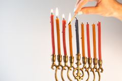 Light candles on chanukiah for a holiday close-up. Horizontal Stock Photography