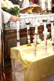 Light candles at the communion Stock Photo