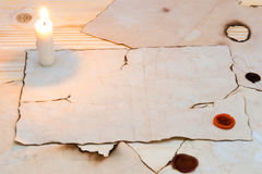 Light candles on an old table Stock Photos