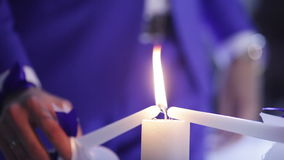 Light Candles. Two candles are lit one common newlyweds candle stock video