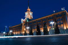 Light car trails in front of Yekaterinburg city center. Administ royalty free stock photo