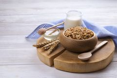 Light carbohydrate and protein rich granola yougurt all-day energy breakfast. Mixed nuts and oats vegeterian super food. A wooden bowl of trail mix with almonds Royalty Free Stock Images