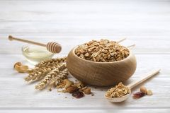 Light carbohydrate and protein rich granola yougurt all-day energy breakfast. A wooden bowl of dried fruit and nuts trail mix with almonds, raisins, seeds Stock Photos