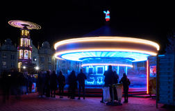 Light Carrousel. Low shutter-speed picture of a carrousel during the Crhistmas Market in France, makes it look like some sort of UFO Royalty Free Stock Photo