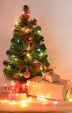 Light celebration on christmas tree with gift box Stock Photos