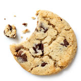 Light chocolate chip cookie, bite missing with crumbs from above royalty free stock image
