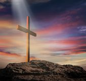 Light from sky . Religion background . The Light of Christ Crucifix . Light of God . Light from sky . Cross on the top of the hill stock photo