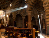 Light in a church. Light beams coming through a windows in a church Stock Photography
