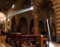 Light in a church. Light beams coming through a windows in a church stock photography