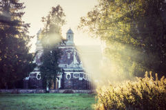 Misty church in morning light Stock Photos