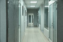 Light clean empty corridor in hospital. Light clean empty corridor in modern hospital royalty free stock photo