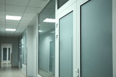 Light clean empty corridor. In modern hospital royalty free stock image