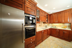 Light clean kitchen with wooden furniture Stock Photos