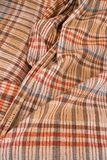 Light cloth with checked / chequered / checkered patter. Fabric is wrinkled and crumpled Stock Photography