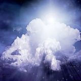 LIght in Clouds. In blue hue Royalty Free Stock Image