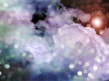 Light in Clouds. Lens flare and bokeh Royalty Free Stock Photos