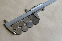 Light coins and vernier caliper
