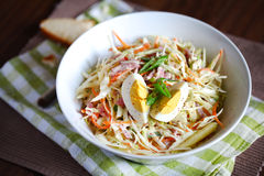Coleslaw salad with hard boiled egg and apples Royalty Free Stock Photos