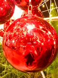 Light colored ball decorated with Christmas. Beautiful furnished fireplace. Red Christmas balls and tinsel stock photos
