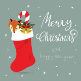 Light colorful christmas greeting card with sock,fox and gold bell Stock Photo