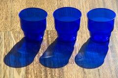 Light, colour, shadow. Dark blue utensils, shadow on a floor Royalty Free Stock Photos