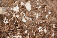Light coloured granite texture with brown and gray spots. Used as a background. Copy space for your text stock photos